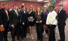Alpha Iota Chi student members and their faculty advisors.