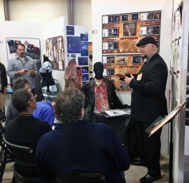 Student T. J. Laws presents his costume designs to the KCACTF judges.