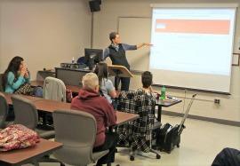 Karen Childress explains the Online Farmer's Market to Northeast business students.