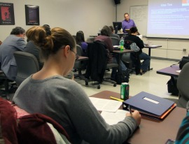 Students take note of tax issues business owners face.