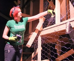 Amanda Haney is one of several students constructing the play's set.
