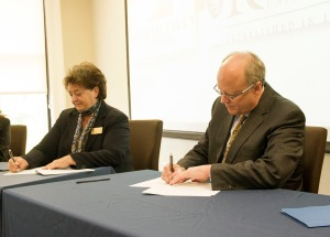 Dr. Janice Gilliam and Dr. Greg Jordan sign the reverse transfer agreement.