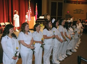 The 2014 class of Nursing student take the Nightingale Pledge.