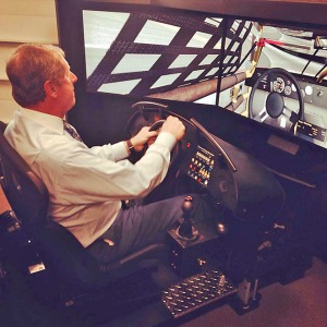 Mitch Walters of the Friendship Family of Dealerships tries out the race simulator at Northeast State.