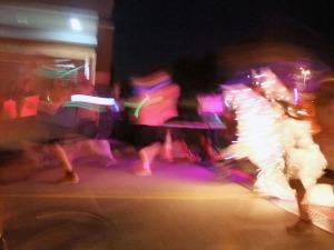Flashes of fleet fluorescent feet are the hallmark of the GLOW Run.