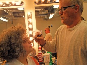 Rachel Lawson's character Ouiser goes through make-up with Russ Onks.